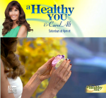Carol Alt receiving Sacred Chocolate from David Wolfe on Fox News